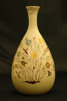 Oriental antique ceramic vase on a black background closeup