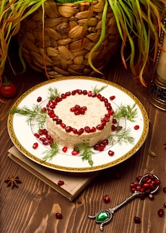 Oriental arabic, turkish food humus with pomegranate seeds.