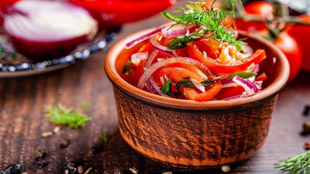 Oriental cuisine concept. uzbek tomato salad with onions. background image. copy space