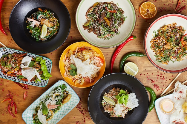 Oriental cuisine dishes on wooden table