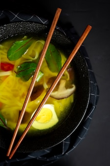 Oriental noodles soup in a restaurant