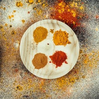 Oriental spices on round wooden plate