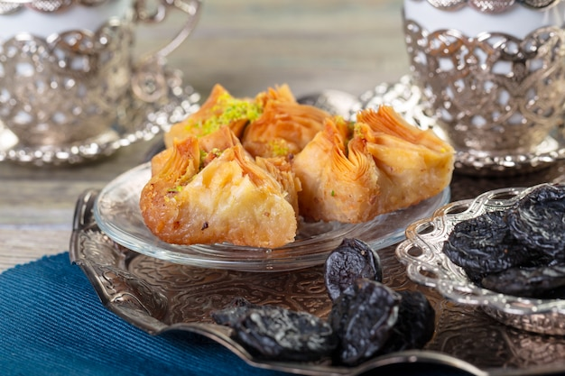 Oriental sweets, baklava, sherbet on a blue
