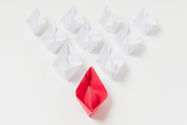 Origami boats leadership concept