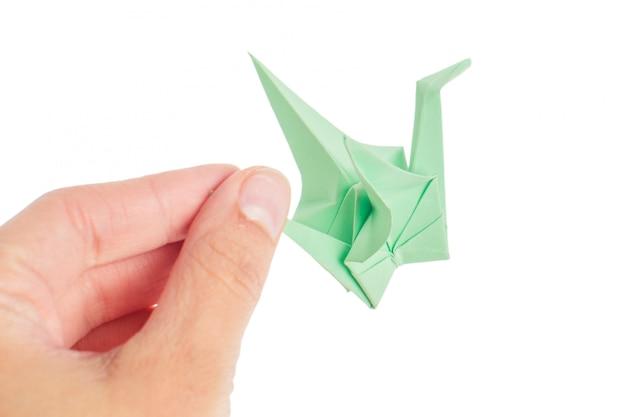 Origami crane on white