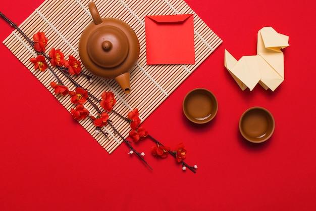 Origami dog near tea ceremony composition
