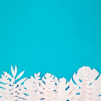Origami exotic paper plants on blue background