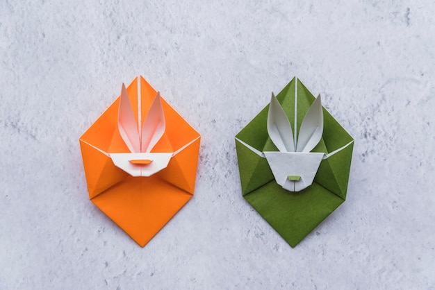 Origami of green and orange rabbits