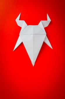 Origami paper goat on red background. new year of the goat 2015.