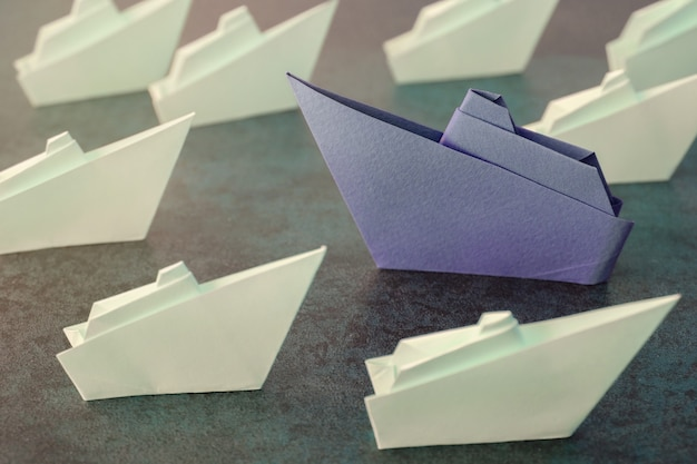 Origami paper ships, change business concept