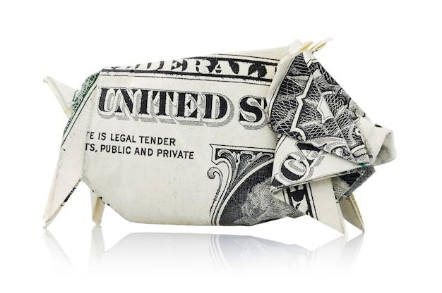 白い背景で隔離豚の形で1米ドルの折り紙貯金箱