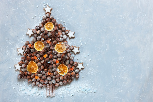 Original christmas tree made of hazelnuts on a wooden table