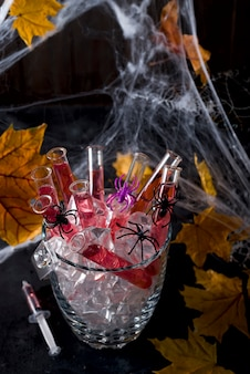 Original cocktail in a glass tube for Halloween party