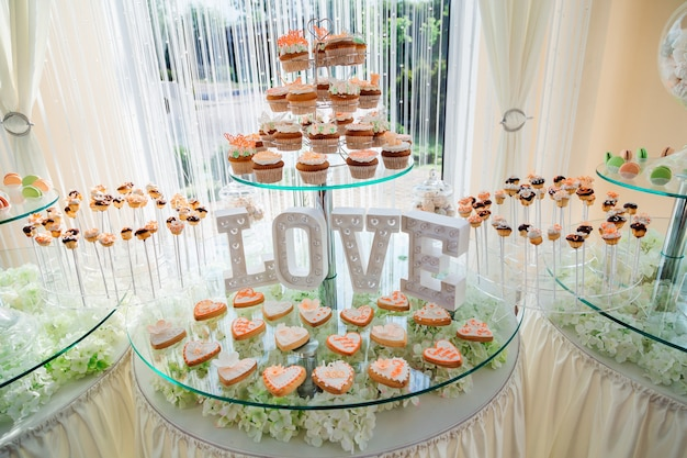 Original cupcakes stand before lettering love on the tired glass