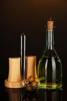 Original glass bottle with oil on dark color background