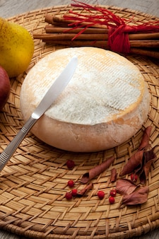 Original italian cheese in wooden table
