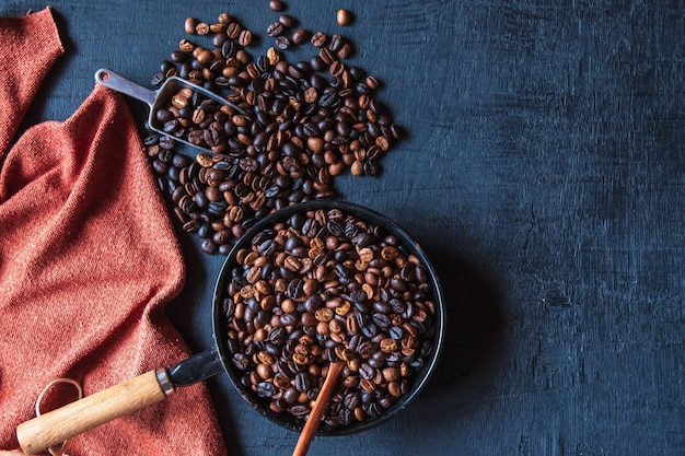 Original roasted coffee beans in a pan