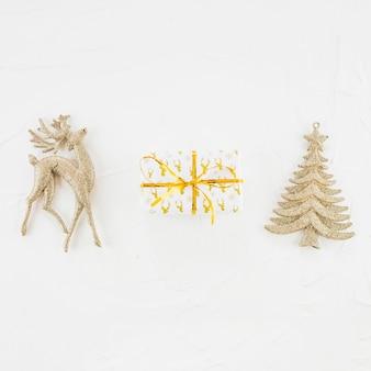 Ornament deer and fir tree near present box