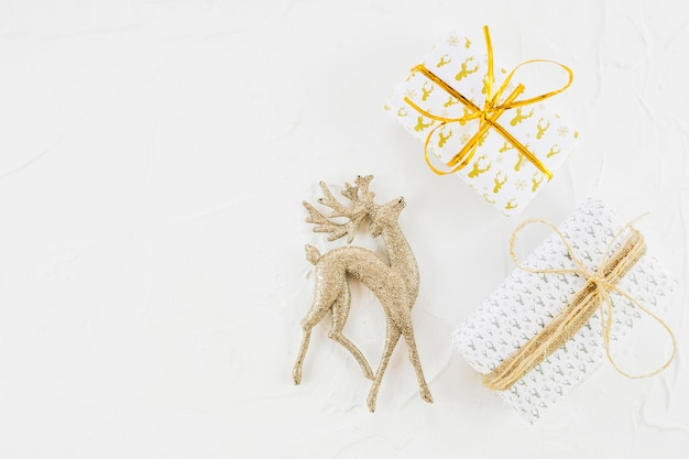 Ornament deer near gift boxes