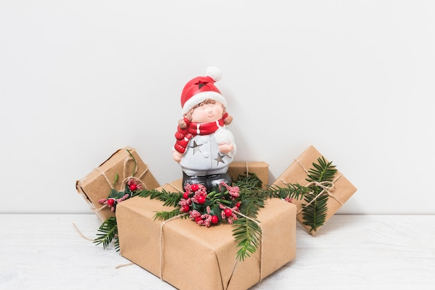 Ornament doll on present boxes