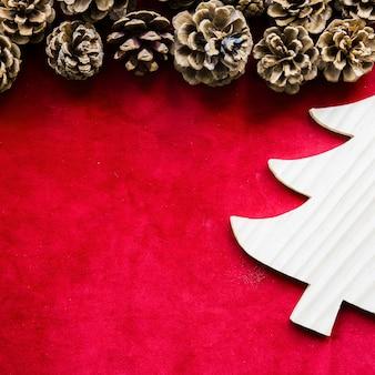 Ornament fir tree near pine snags