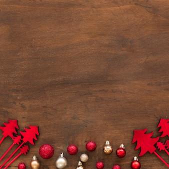 Ornament fir trees near set of Christmas baubles