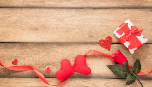 Ornament hearts near flower and present box