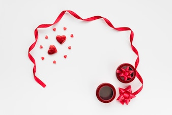 Ornament hearts near ribbon and bows