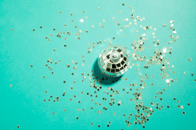 Ornament silver bauble near decorative stars
