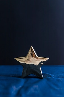 Ornament star on blue bed sheet