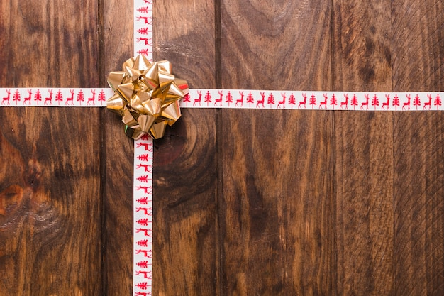 Ornamental christmas wooden background with bow