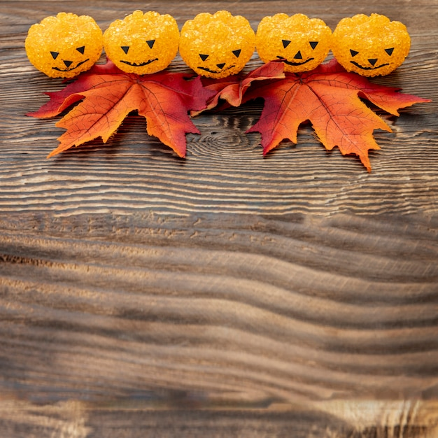 Ornamental halloween pumpkins on wooden table