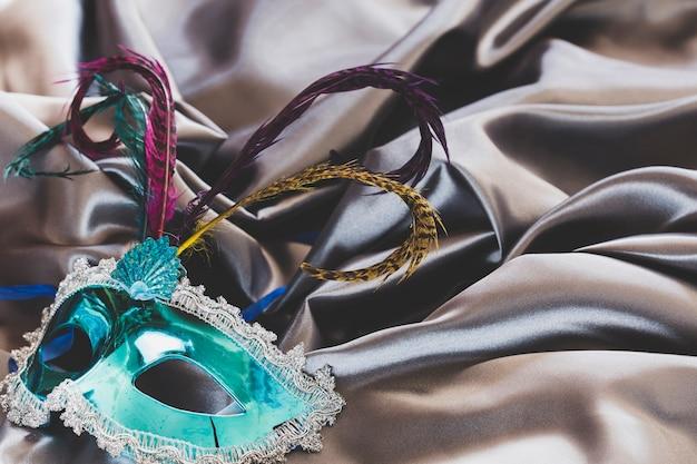 Ornamental mask on silky fabric
