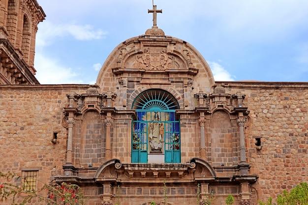 Ornate facade of basilica menor de la merced in the historic center of the city of cusco, peru