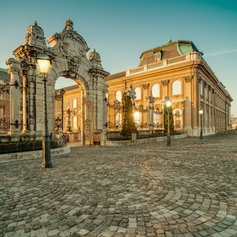 Ornate gates into buda castle in budapest early morning