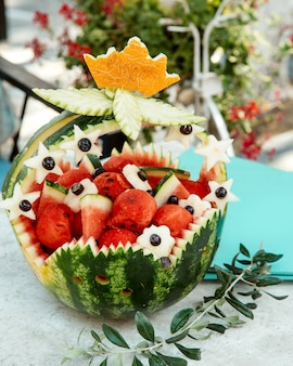 Ornated watermelon basket with watermelons pieces