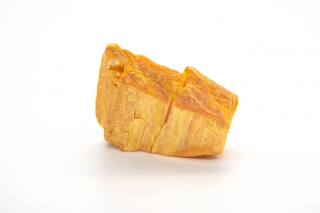 Orpiment mineral - arsenic sulfide isolated on white