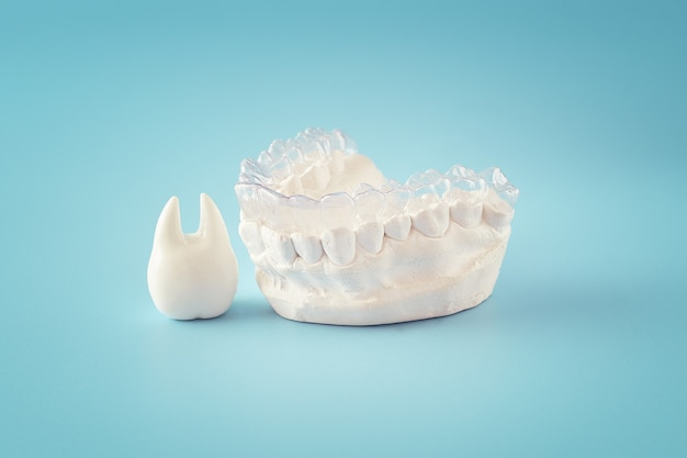 Orthodontic dental theme on blue  background.transparent invisible dental aligners or braces aplicable for an orthodontic dental treatment