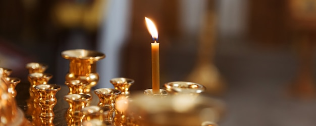 Orthodox church. christianity. festive interior decoration with burning candles and icon in traditional orthodox church on easter eve or christmas. religion faith pray symbol.