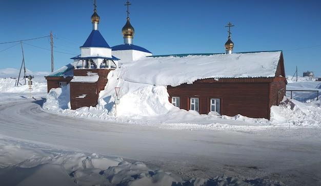 Orthodox church flooded in snow