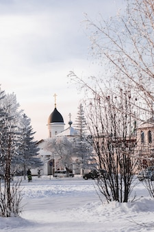 Orthodox church. winter landscape. winter road and trees covered with snow.