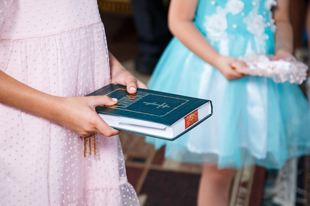 Orthodox religion. girl hands on the bible.
