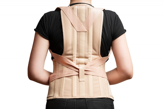 Orthopedic corset on the female body isolated on a white surface
