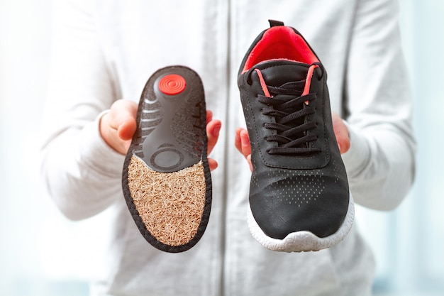 Orthopedic insoles for sports shoes. treatment and prevention of flatfeet and orthopedic foot diseases. foot care, feet comfort. health care, wearing comfortable shoes