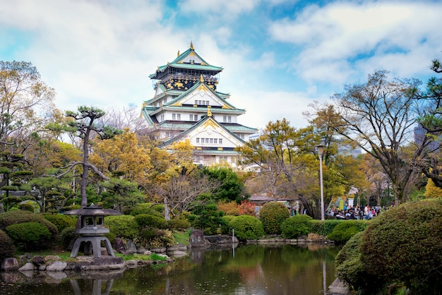 Osaka castle with japanese garden and tourist sightseeing at osaka, japan.