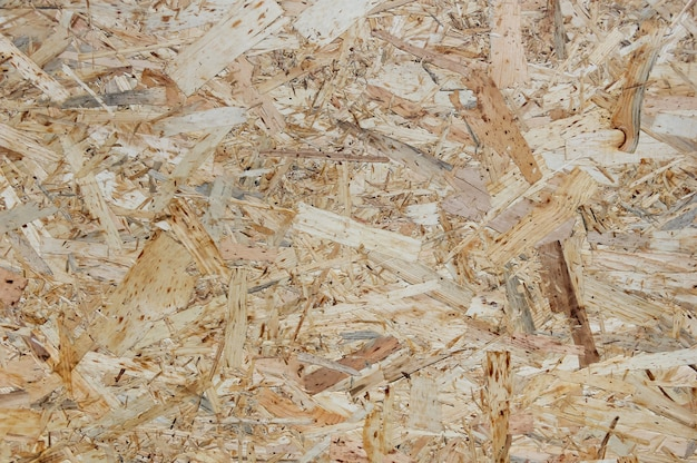 Osb boards are made of wood chips. top view osb veneer background.