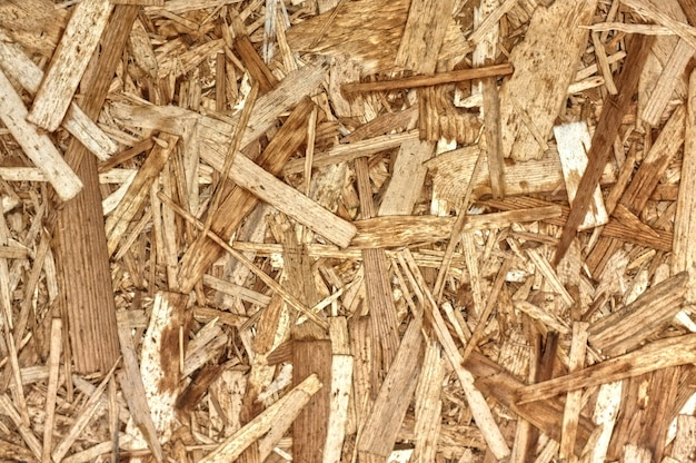 Osb boards or brown wood chips sanded into a wooden