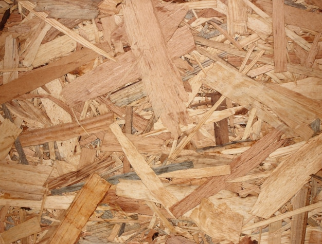 Osb material texture - recycled compressed wood chippings board plywood texture.