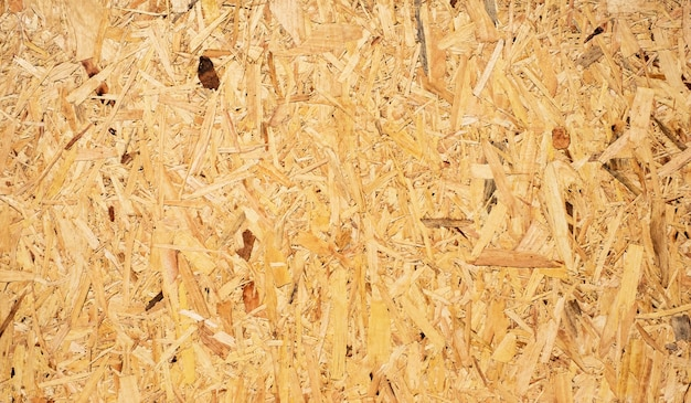 Osb sheet is made of brown wood background.