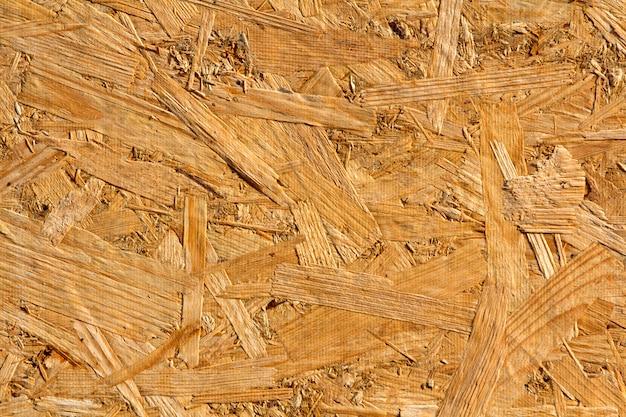 ウッドテクスチャ。背景装飾用の配向ストランドのosb木製プレスボード
